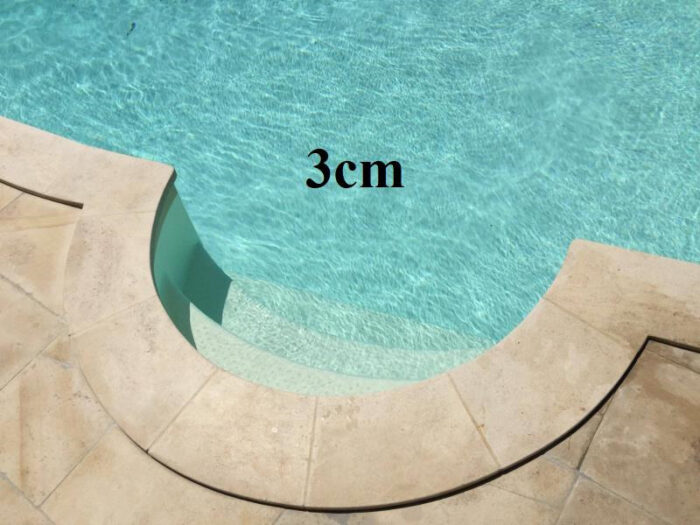 Romaine piscine pierre naturelle margelle