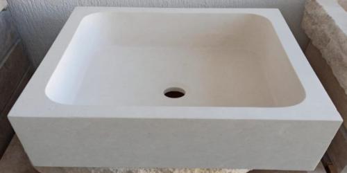 Vasque lave-mains en pierre beige clair uni